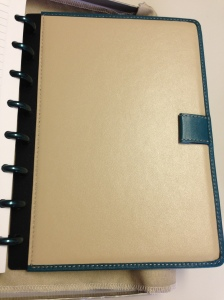 The back features Dune leather and a Teal leather/elastic pen loop