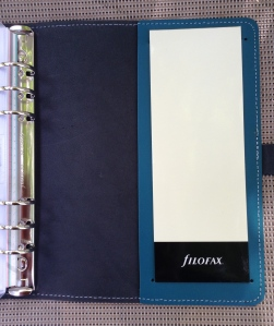 The inside back has the Flex-esque jot pad and a slip pocket behind.